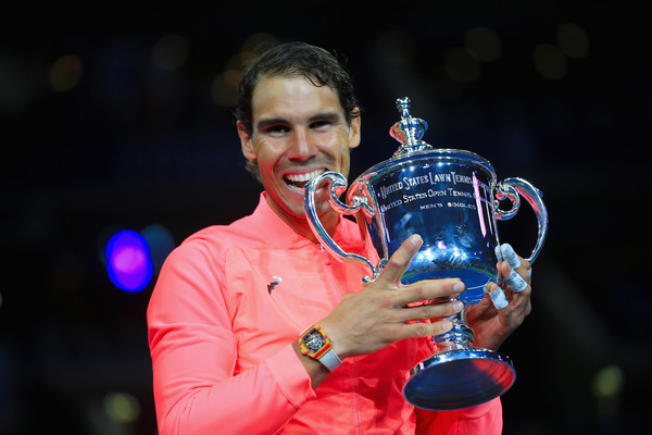 Rafael Nadal bit into the trophy last year in New York and will look to add a fourth title this year. Photo: Chris Trotman/Getty Images