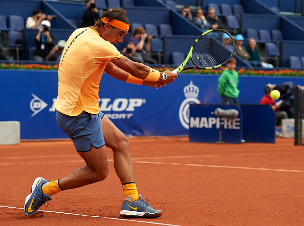 Nadal blasts a backhand. Photo: Manuel Queimadelos Alonso/Getty Images
