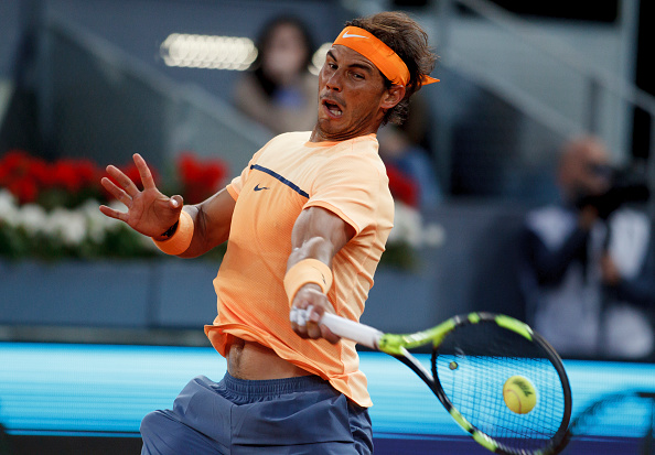 Rafael Nadal crushes a forehand during his third round win. Photo: Guillermo Martinez/Corbis via Getty Images