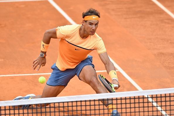 Rafael Nadal returns one of Djokovic's many drop shots. Photo: Claudio Pasquazi /Anadolu Agency/Getty Images