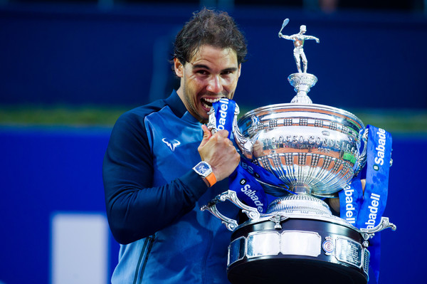 Rafael Nadal bites his Barcelona Open trophy after claiming the title in April. Photo: Alex Caparros/Getty Images