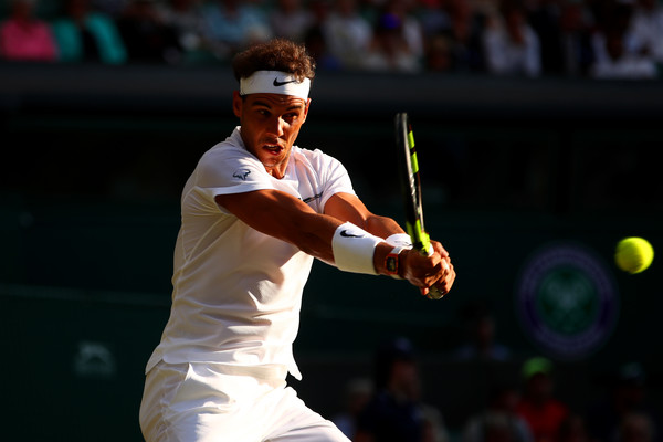 Nadal powers through a backhand against Young. Photo: Clive Brunskill/Getty Images