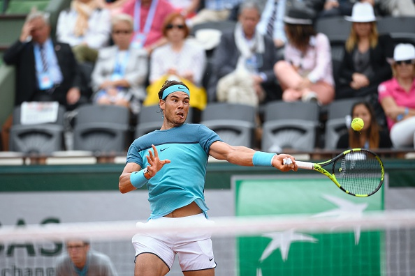 Rafael Nadal crushes one of his giant forehands. Photo: Martin Bureau/AFP/Getty Images