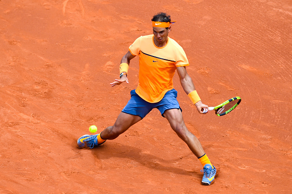 Rafael Nadal slides into a forehand during his third round win. Photo: David Ramos/Getty Images