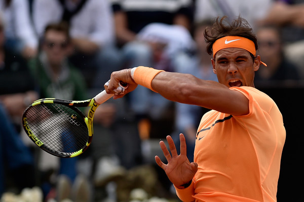 Rafael Nadal crushes a forehand during the third round match. Photo: Dennis Grombkowski/Getty Images