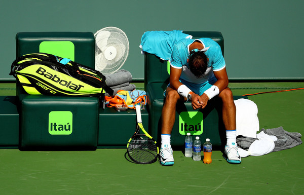 Nadal sits in his chair during the third set before retiring. Photo: Mike Ehrmann/Getty Images