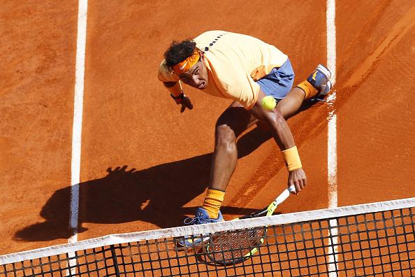 Rafael Nadal slides to retrieve a drop shot. Photo: Valery Hache/AFP/Getty Images