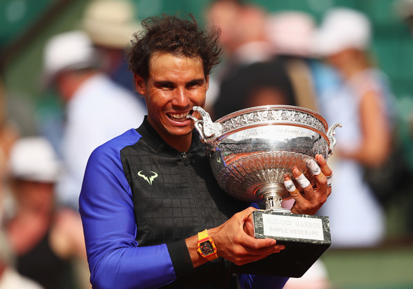 Rafael Nadal bites his trophy at last month's French Open. Photo: Clive Brunskill/Getty Images