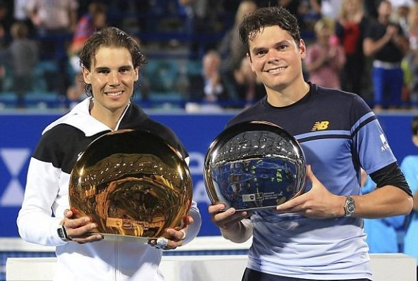 Raonic (right) and Rafael Nadal hold their trophies after their 2016 Abu Dhabi final. Photo: Reuters