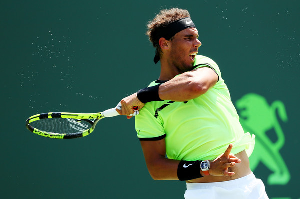 Nadal follows through on a forehand in the semifinals. Photo: Al Bello/Getty Images