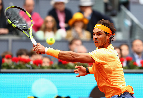 Rafael Nadal lunges for a backhand during the semifinal. Photo: Clive Brunskill/Getty Images