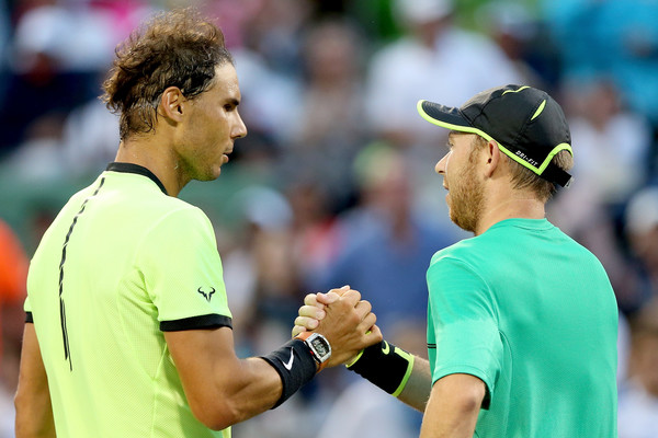 Nadal (left) shakes hands with Dudi Sela after the match. Photo: Matthew Stockman/Getty Images