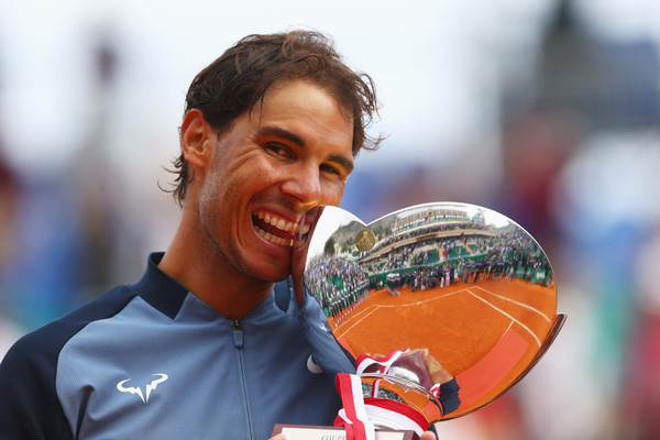 Rafael Nadal bites his 2016 Monte Carlo Rolex Masters trophy. Photo: Michael Steele/Getty Images