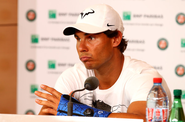 Rafael Nadal wearing a cast on his wrist at his withdrawal press conference in Paris. Photo: Clive Brunskill/Getty Images