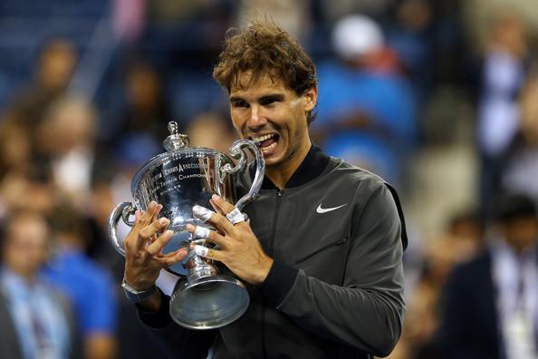 Nadal bites his 2013 US Open trophy. Photo: Elsa/