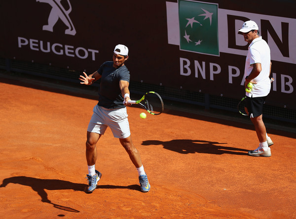 Rafael Nadal (left) hits a ball in practice as Toni Nadal watches at the French Open. Photo: Matthew Lewis/Getty Images