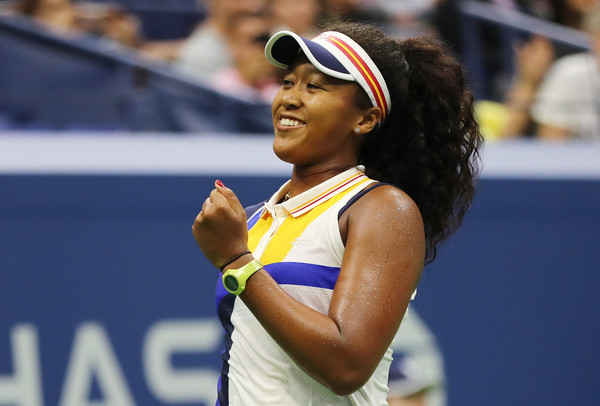 A happy Naomi Osaka celebrates after defeating Angelique Kerber in the first round of the 2017 U.S. Open. | Photo: Elsa/Getty Images