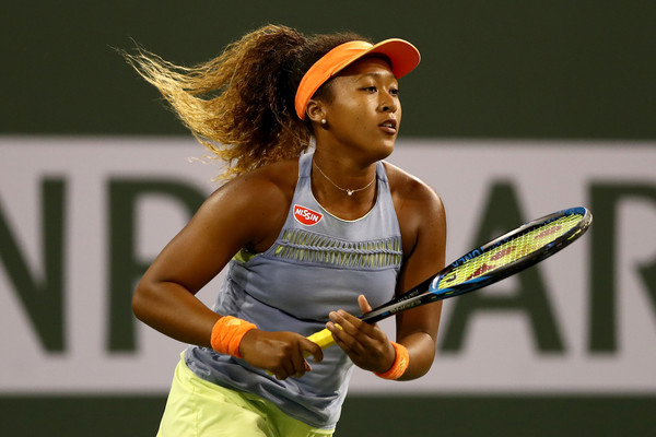 Naomi Osaka looks to ride on her momentum and upset world number one Simona Halep in the semifinals | Photo: Matthew Stockman/Getty Images North America
