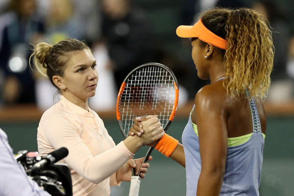 Osaka and Halep meet at the net after the match for a warm handshake   Photo: Matthew Stockman/Getty Images North America
