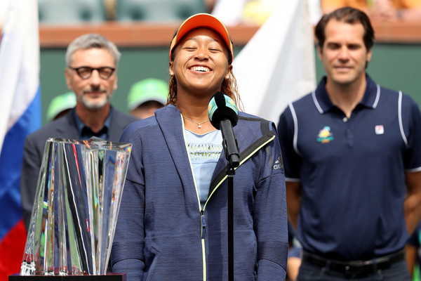 Naomi Osaka having a laugh during the trophy ceremony at the BNP Paribas Open | Photo: Matthew Stockman/Getty Images North America