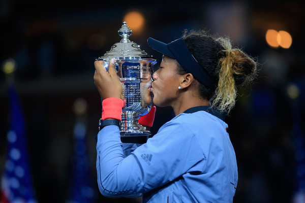 Naomi Osaka kisses the winner's trophy after winning the 2018 U.S. Open—a victory that she 100 percent earned. | Photo: Chris Trotman/Getty Images
