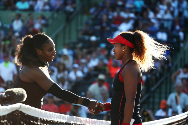 Naomi Osaka (R) and Serena Williams shake hands after Osaka defeated her childhood idol in straight sets in the first meeting earlier this year at the Miami Open. The two will face off for the 2018 U.S. Open title on Saturday. | Photo: Al Bello/Getty Images