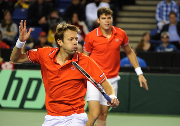 Daniel Nestor hits a volley during a doubles rubber in 2012. Photo: Don MacKinnon/AFP/Getty Images