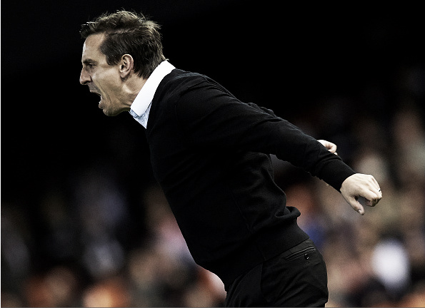 Gary Neville is finding the touchline harder than the TV studio (Photo: Manuel Qyeimadelos Alonso / Getty Images)
