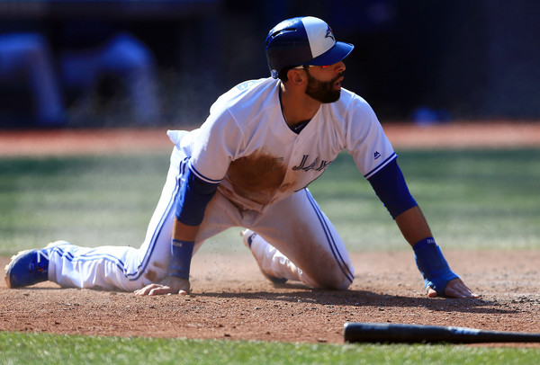 José Bautista reacts to being called out at home in the fourth inning, much to the dismay of more than 47,000 fans inside Rogers Centre. | Photo: Vaughn Ridley/Getty Images