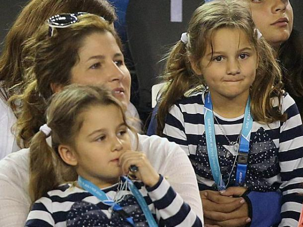 Mirka and her two daughters look on from Federer's player box at the Australian Open. Credit: News Corp Australia