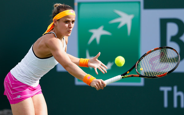 Nicole Gibbs strikes a backhand volley. Photo: Julian Finney/Getty Images
