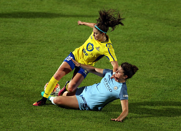 Humphrey battles for the ball with Jennifer Beattie (credit: Nigel Roddis/Getty)