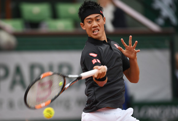 Kei Nishikori hits a forehand at the French Open. Photo: Dennis Grombkowski/Getty Images