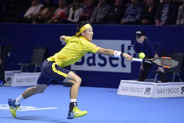 Nishikori lunges for a backhand on Saturday in Basel. Photo: Harold Cunningham/Getty Images