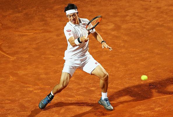 Kei Nishikori hits a forehand during his quarterfinal win. Photo: Matthew Lewis/Getty Images