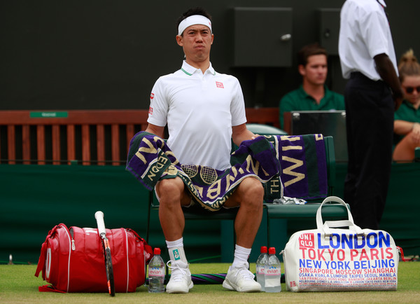 Nishikori looks uncomfortable during his fourth-round retirement loss at Wimbeldon. Photo: Adam Pretty/Getty Images