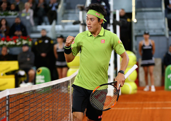 Kei Nishikori pumps his fist during his semifinal. Photo: Clive Brunskill/Getty Images
