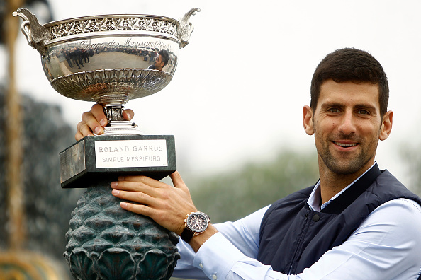 Djokovic  celebrates the victory in Paris and poses for the photographers with the trophy in front of the fountain at the concord near Champs Elysees in Paris, on June 6, 2016. (Photo by Mehdi Taamallah/NurPhoto via Getty)