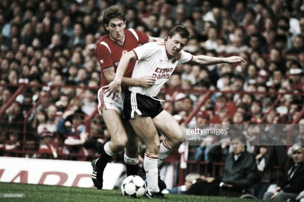 Whiteside tussles with Liverpool's Steve Nicol (Photo: Getty Images)