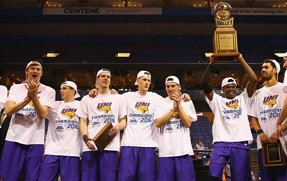 Wes Washpun #11 of the Northern Iowa Panthers holds the during the MVC Basketball Tournament championship trophy after beating the Evansville Aces / Dilip Vishwanat - Getty Images