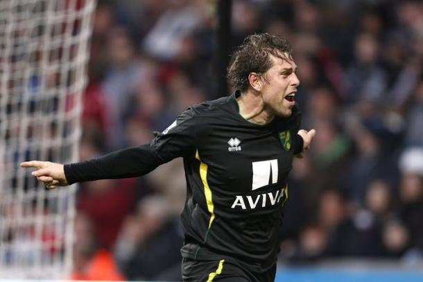 Grant Holt celebrates after scoring in Norwich's 4-3 win over Swansea back in 2012. | Photo: Reuters