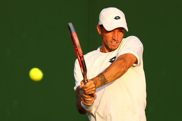 Dennis Novak strikes a backhand during his round three loss to Raonic. Photo: Michael Steele/Getty Images