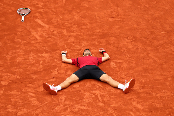 Djokovic soaks in the scale of his achievement at the French Open in 2016 (Photo: Julian Finney/Getty Images Europe)