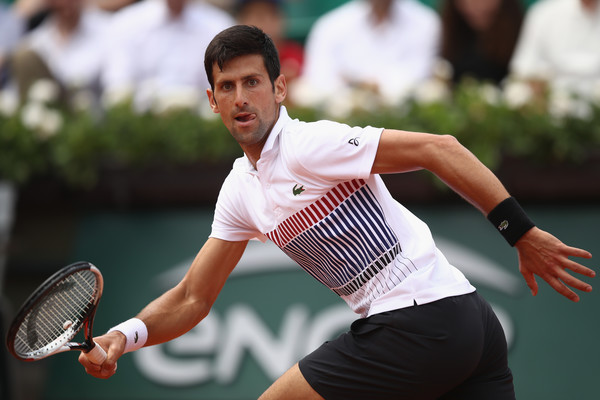 Novak Djokovic runs to reach out for a shot | Photo: Julian Finney/Getty Images Europe
