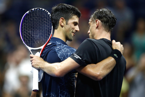 Djokovic and Millman share a warm embrace after the match | Photo: Julian Finney/Getty Images North America