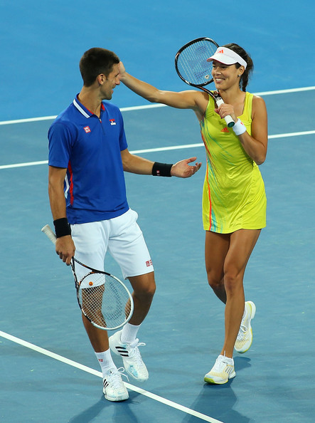 Novak Djokovic and Ana Ivanovic joke around in-between points during the 2014 Hopman Cup. | Photo: Paul Kane/Getty Images AsiaPac