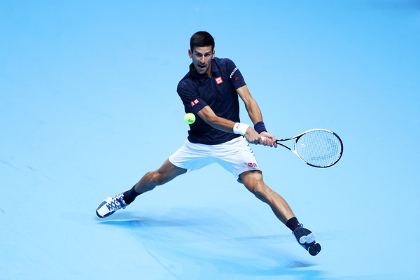 Djokovic reaches for the ball (Photo by Clive Brunskill/Getty Images)