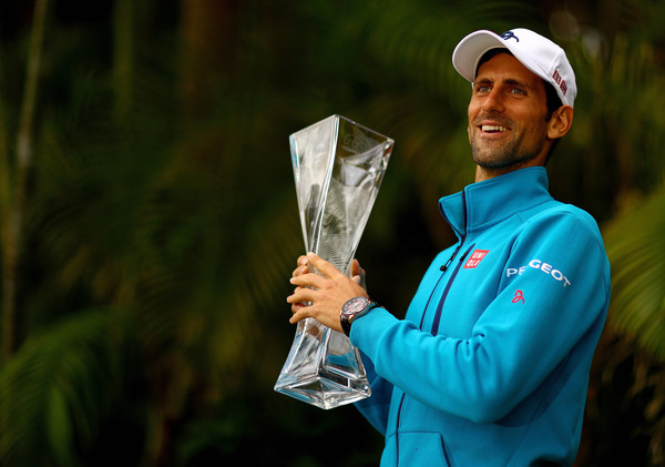 Djokovic poses with his Miami Open trophy. Photo: Mike Ehrmann/Getty Images