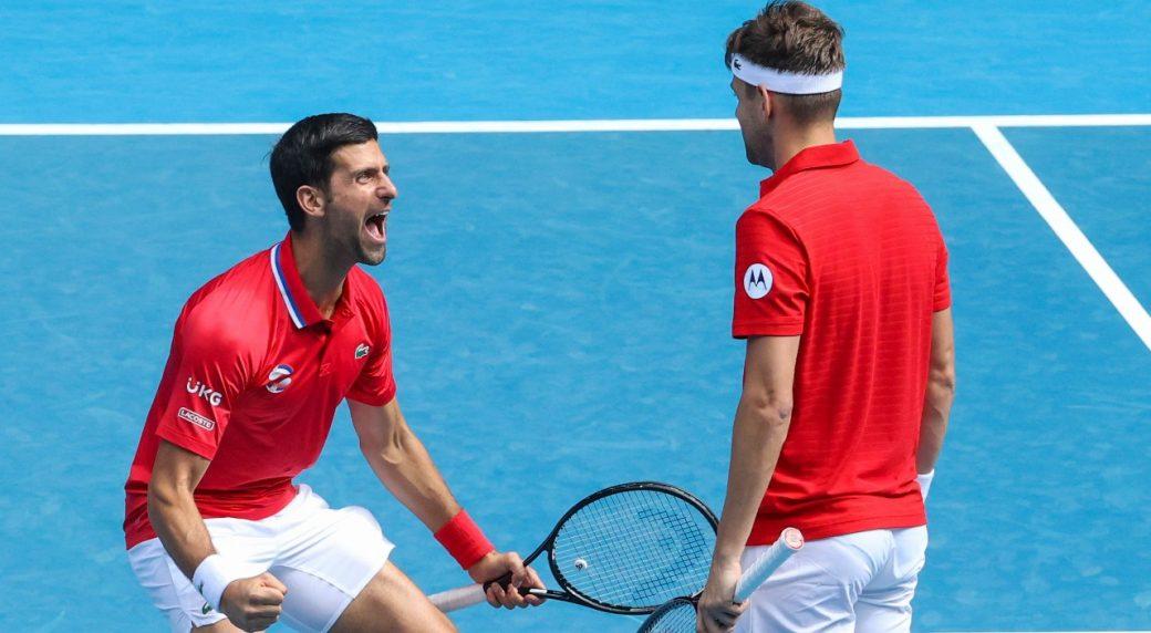 Djokovic (l.) celebrates with Krajinovic (r.) as Serbia came through their opening ATP Cup tie/Photo: Hamish Blair/Associated Press