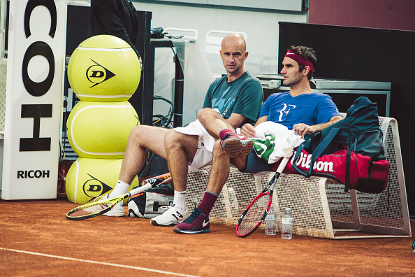 Federer sits with his coach, Ivan Ljubicic, during his practice in Rome. Credit: NurPhoto/Getty Images
